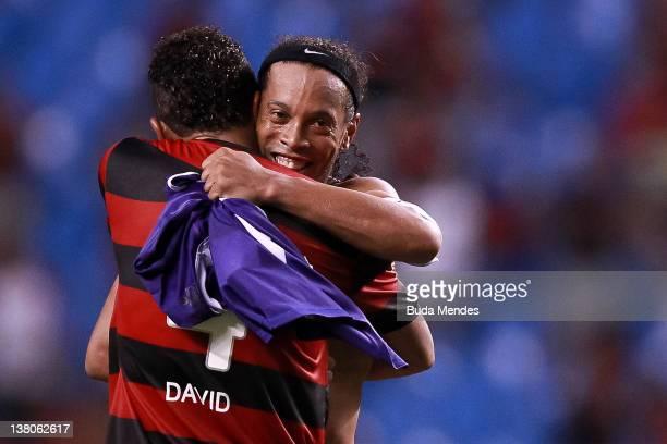 Ronaldinho and David of Flamengo celebrate a victory after a match between Flamengo v Real Potosi as part of Santander Libertadores Cup 2012 at...