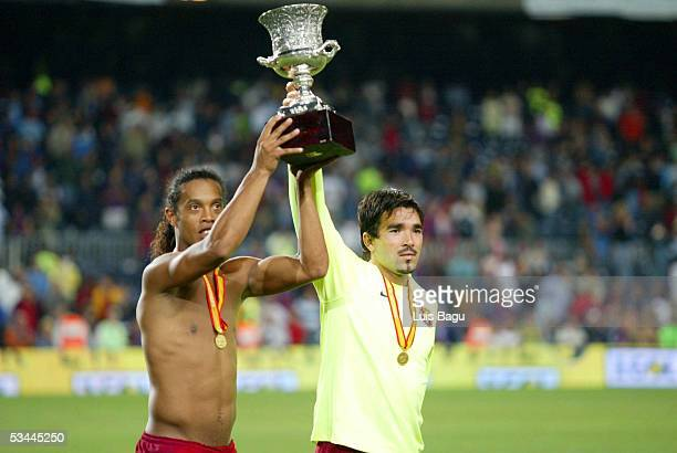 Ronaldinho and Deco of FC Barcelona are seen with the trophy after winning the match between FC Barcelona and Real Betis during the Spain Supercup...