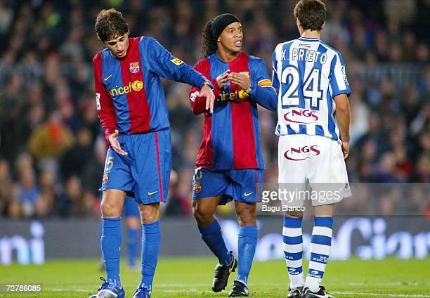 Ronaldinho and Edmilson of Barcelona walk past Xabier Prieto of Real Sociedad during the La Liga match between FC Barcelona and Real Sociedad at the...