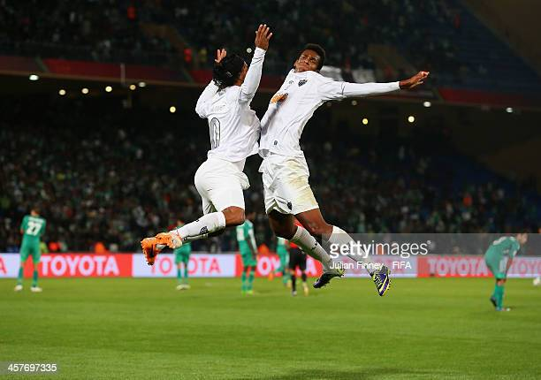 Ronaldinho and Jo of Atletico Mineiro celebrate Ronaldinho's goal to make it 11 during the FIFA Club World Cup Semi Final match between Raja...