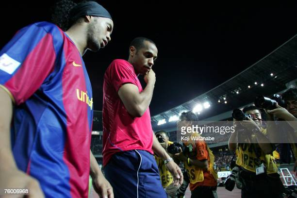 Ronaldinho and Thierry Henry of Barcelona leave the field after a friendly match against Yokohama Marinos at Nissan Stadium on August 7 2007 in...