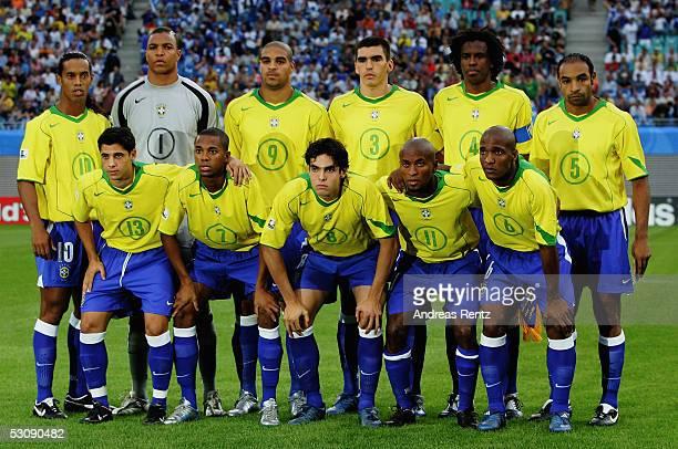 Ronaldinho Cicinho Dida Robinho Adriano Kaka Lucio Ze Roberto Roque Junior Gilberto and Emerson of the Team Brazil stands up for a teamphoto before...