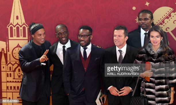 Ronaldinho Clarence Seedorf Lothar Matthaeus and Nwankwo Christian Kanu arrive to attend the Final Draw for the 2018 FIFA World Cup football...