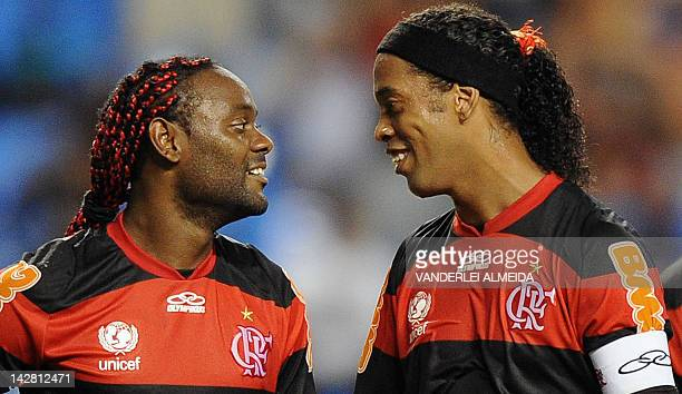 Ronaldinho Gaucho and Vagner Lover of Flamengo team smile during the Copa Libertadores football match against Argentina's Lanus at the Joao Havelange...