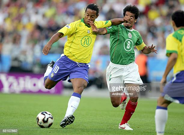 Ronaldinho Gaucho of Brazil and Pavel Pardo of Mexico fight for the ball during the FIFA Confederations Cup 2005 match between Mexico and Brazil on...