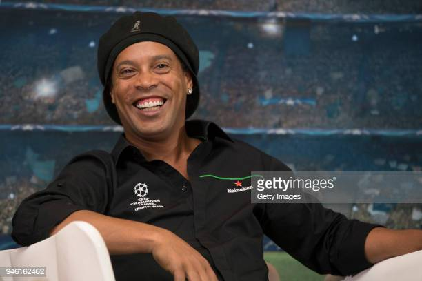 Ronaldinho Heineken Ambassador is pictured during a press briefing with the UEFA trophy during the UEFA Champions League Trophy Tour Presented by...
