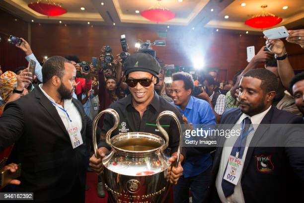 Ronaldinho Heineken Ambassador is pictured entering a press briefing with the UEFA trophy during the UEFA Champions League Trophy Tour Presented by...