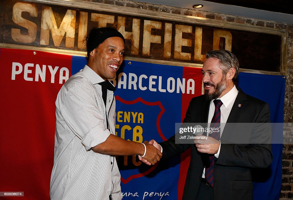 Ronaldinho is greeted by Jordi Getman-Eraso, President of Penya FC Barcelona New York City at Smithfield Hall on September 7, 2016 in New York City.