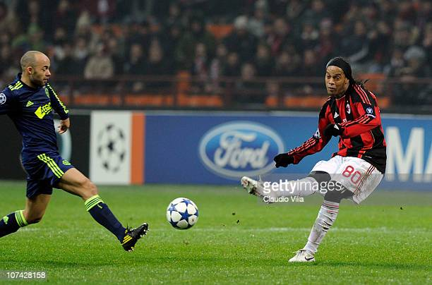 Ronaldinho of AC Milan and Demy de Zeeuw of AFC Ajax compete for the ball during the UEFA Champions League Group G match between AC Milan and AFC...