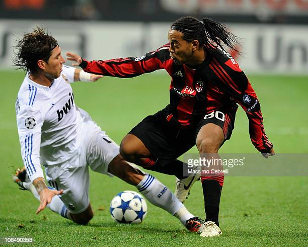 Ronaldinho of AC Milan battles for the ball against Sergio Ramos of Real Madrid during the Uefa Champions League group G match between AC Milan and...