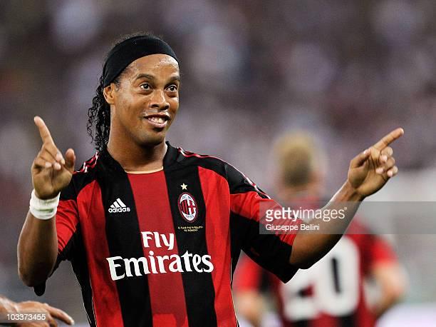 Ronaldinho of AC Milan celebrates after scoring the opening goal during the TIM preseason tournament at Stadio San Nicola on August 13 2010 in Bari...