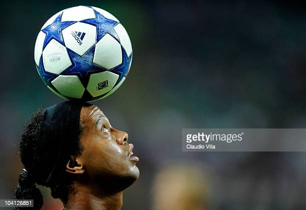 Ronaldinho of AC Milan controls the ball with his head during the UEFA Champions League group G match between AC Milan and Auxerre at San Siro...