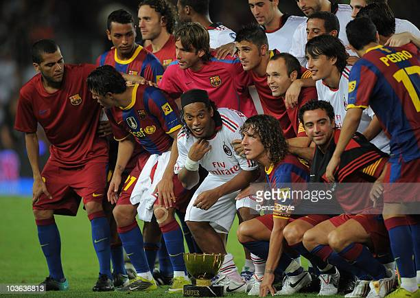 Ronaldinho of AC Milan joined his former Barcelona teammates after the Joan Gamper Trophy match between Barcelona and AC Milan at Camp Nou stadium on...
