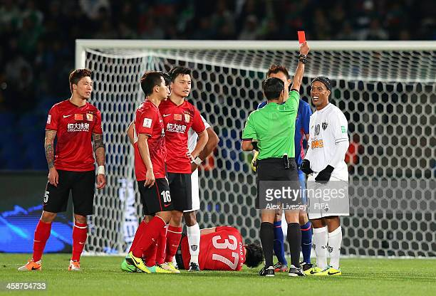 Ronaldinho of Atletico Mineiro is sent off by referee Alireza Faghani during the FIFA Club World Cup 3rd place match between Guangzhou Evergrande FC...