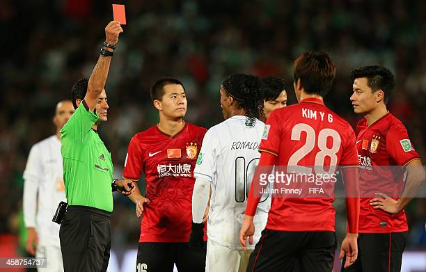 Ronaldinho of Atletico Mineiro is shown a red card by referee Alireza Faghani during the FIFA Club World Cup 3rd Place Match between Guangzhou...