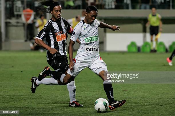 Ronaldinho of Atlético MGfights for the ball during a match between Atlético MG and Figueirense as part of the Brazilian Chapmionship 2012 at...