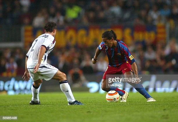 Ronaldinho of Barcelona and Jose Izquierdo of Osasuna in action during the match between FC Barcelona and Osasuna of the Spanish Primera Liga on...