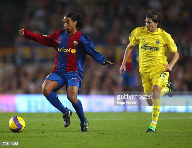 Ronaldinho of Barcelona and Ruben Garcia Cani of Villarreal in action during the match between FC Barcelona and Villarreal of La Liga on November...
