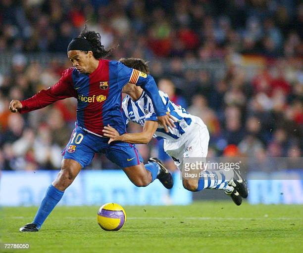 Ronaldinho of Barcelona and Xabier Prieto of Real Sociedad during the La Liga match between FC Barcelona and Real Sociedad at the Camp Nou on...