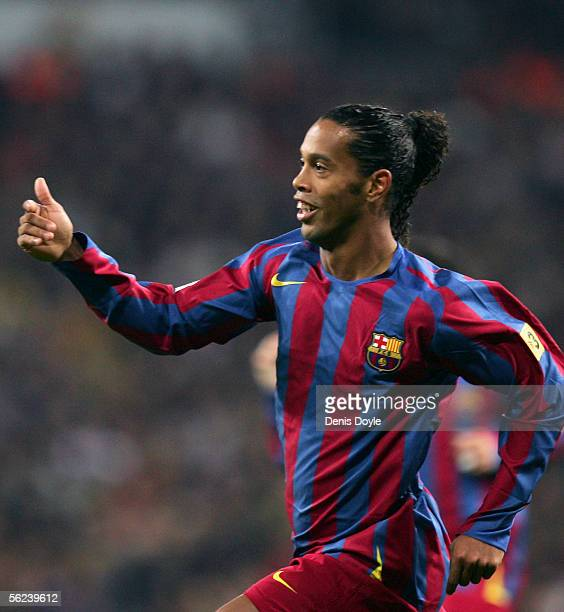 Ronaldinho of Barcelona celebrates after scoring a goal during a Primera Liga match between Real Madrid and FC Barcelona at the Bernabeu on November...