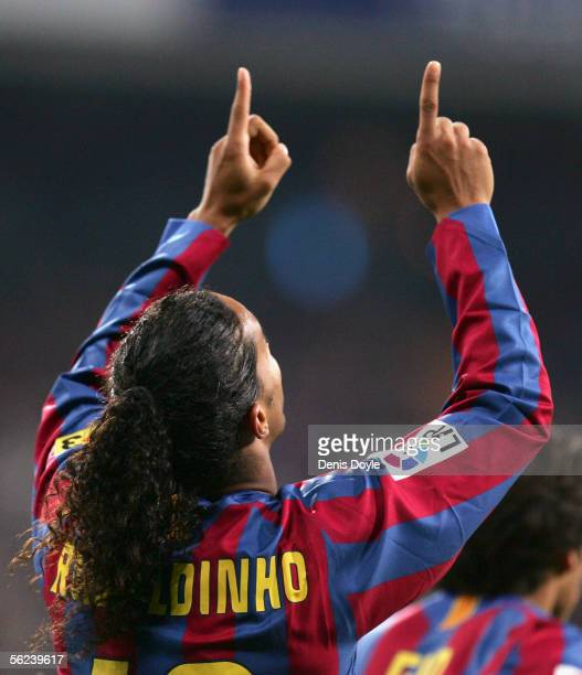 Ronaldinho of Barcelona celebrates after scoring a goal during a Primera Liga match between Real Madrid and FC Barcelona at the Bernabeu on November...