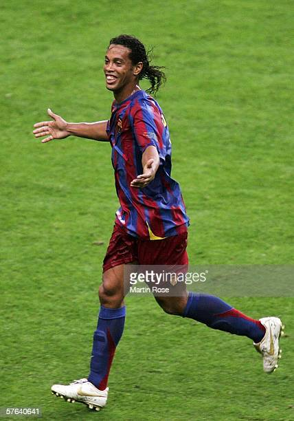 Ronaldinho of Barcelona celebrates his sides victory in the UEFA Champions League Final between Arsenal and Barcelona at the Stade de France on May...