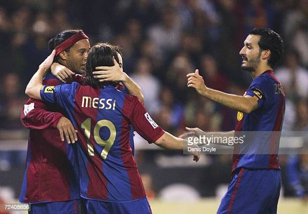 Ronaldinho of Barcelona celebrates with Lionel Messi after scoring from the penalty spot during a Primera Liga match between Deportivo La Coruna and...