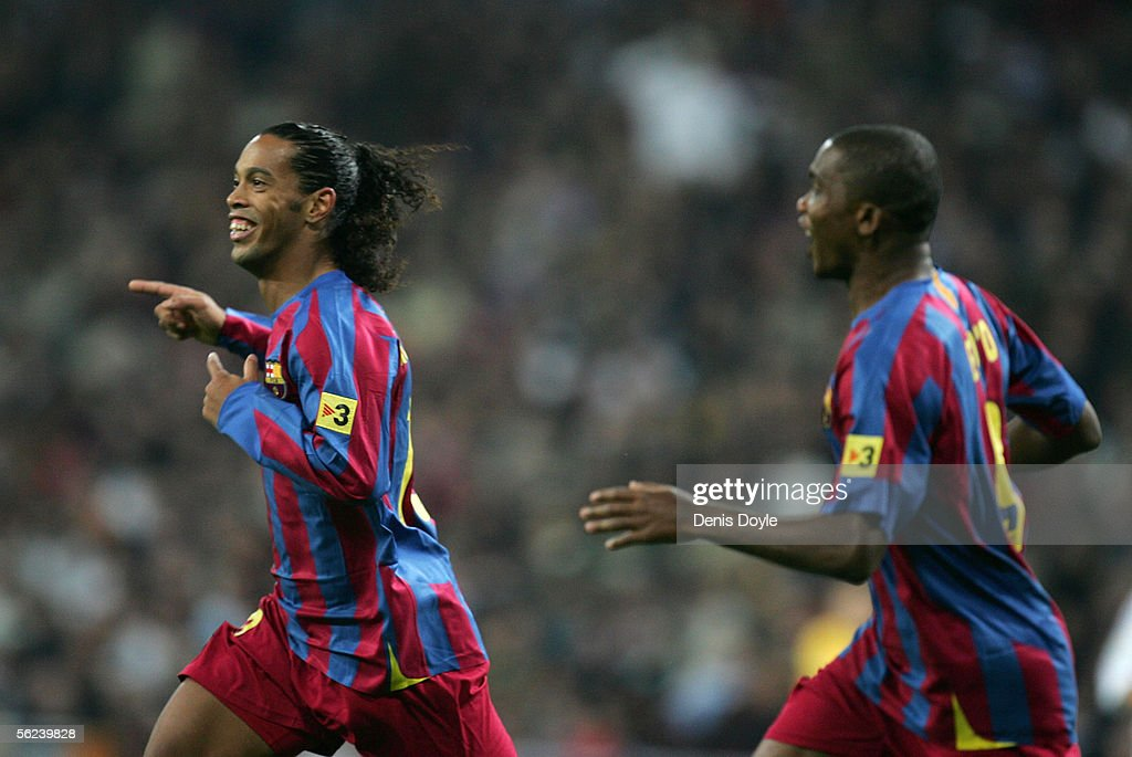 Ronaldinho (L) of Barcelona celebrates with Samuel Eto'o after scoring a goal during a Primera Liga match between Real Madrid and F.C. Barcelona at the Bernabeu on November 19, 2005 in Madrid, Spain.