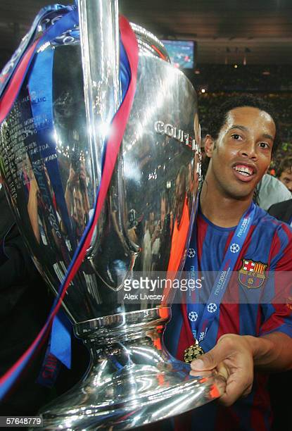 Ronaldinho of Barcelona celebrates with the trophy following the UEFA Champions League Final between Arsenal and Barcelona at the Stade de France on...