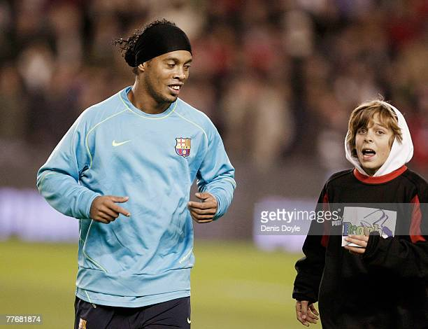 Ronaldinho of Barcelona chats with a young fan while warming up for the La Liga match between Valladolid and Barcelona at the Jose Sorillo stadium on...
