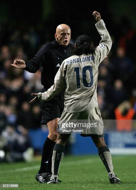 Ronaldinho of Barcelona complains at Pierluigi Collina the referee during the UEFA Champions League First Knockout Round Second Leg match between...
