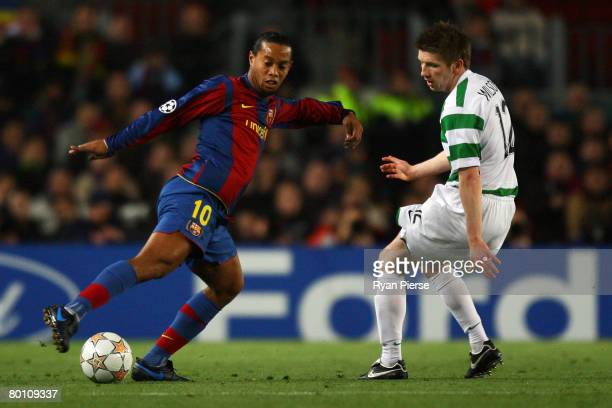 Ronaldinho of Barcelona gets past Mark Wilson of Celtic during the UEFA Champions League 2nd leg of the First knockout round match between FC...
