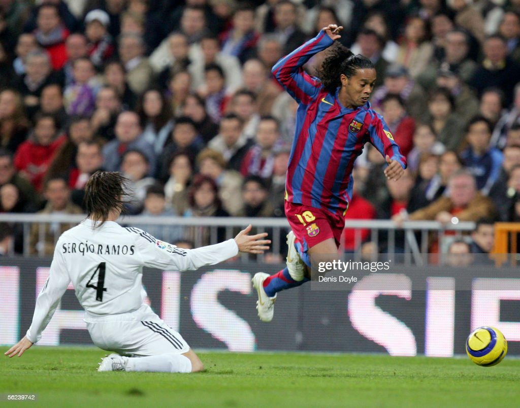 Ronaldinho (R) of Barcelona gets past Sergio Ramos of Real Madrid during a Primera Liga match between Real Madrid and F.C. Barcelona at the Bernabeu on November 19, 2005 in Madrid, Spain.