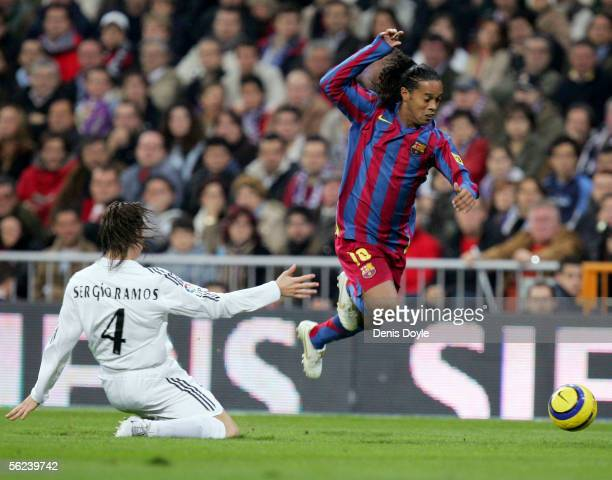 Ronaldinho of Barcelona gets past Sergio Ramos of Real Madrid during a Primera Liga match between Real Madrid and FC Barcelona at the Bernabeu on...
