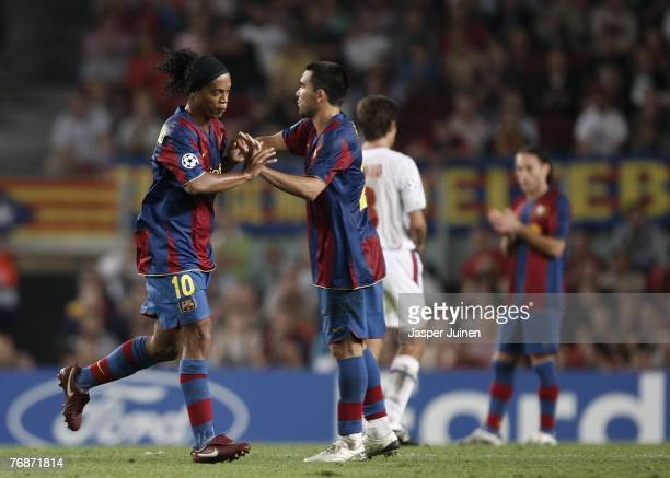 Ronaldinho of Barcelona greets his teammate Deco as he is being substituted during the UEFA Champions League Group E match between Barcelona and Lyon...