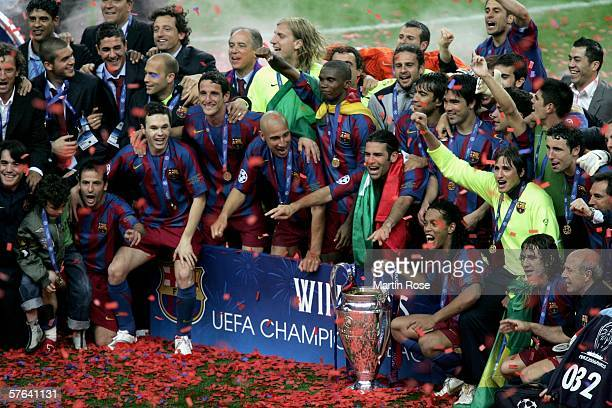 Ronaldinho of Barcelona holds the trophy alongside celebrating team mates after they win the UEFA Champions League Final between Arsenal and...