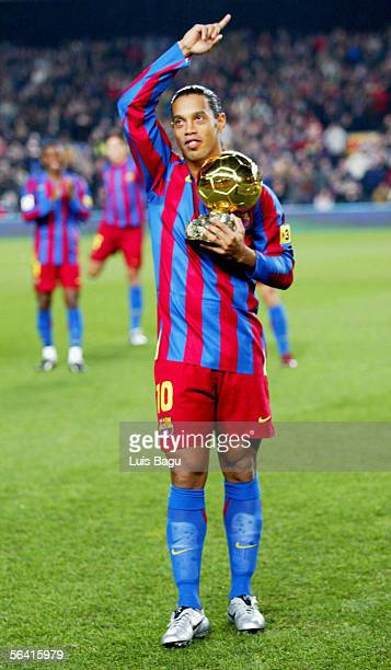 Ronaldinho of Barcelona is applauded by his teammates as he holds the Ballon D'Or award for European Footballer of the Year on the pitch before the...