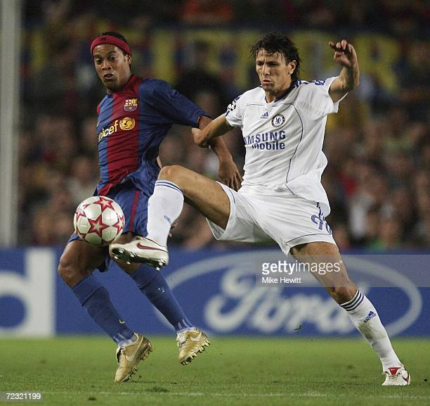 Ronaldinho of Barcelona is challenged by Khalid Boulahrouz of Chelsea during the UEFA Champions League group A match between Barcelona and Chelsea at...