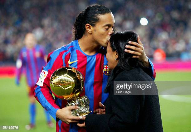 Ronaldinho of Barcelona kisses his mother as he holds the Ballon D'Or award for European Footballer of the Year on the pitch before the Primera Liga...
