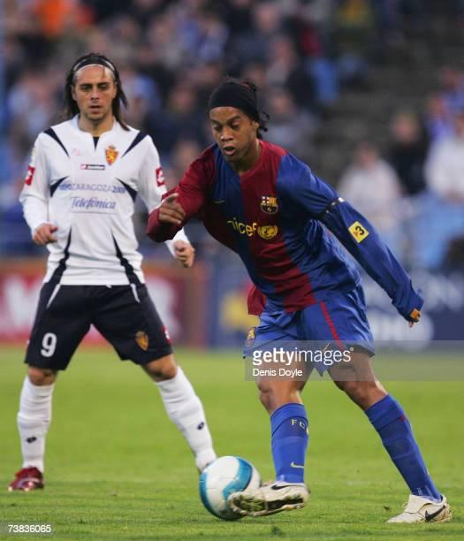 Ronaldinho of Barcelona passes the ball beside Sergio Garcia of Real Zaragoza during the Primera Liga match between Real Zaragoza and Barcelona at...