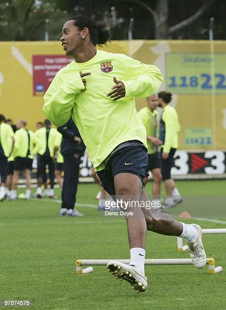 Ronaldinho of Barcelona runs during a team training session at the UEFA Champions League Media Day in the Masia club training grounds on May 10 2006...