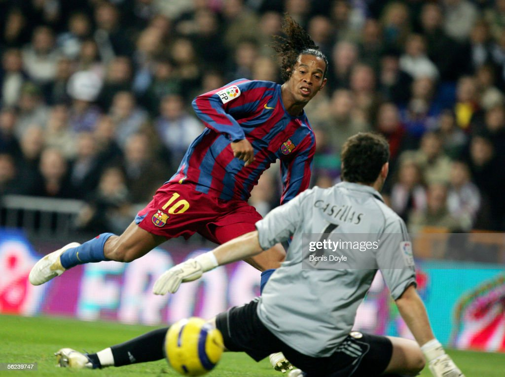 Ronaldinho of Barcelona scores a goal against Real Madrid goalkeeper Iker Casillas during a Primera Liga match between Real Madrid and F.C. Barcelona at the Bernabeu on November 19, 2005 in Madrid, Spain.