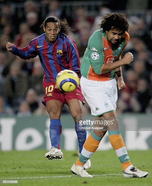 Ronaldinho of Barcelona shoots and is blocked by Patrick Owomoyela of Bremen during the UEFA Champions League Group C match between FC Barcelona and...