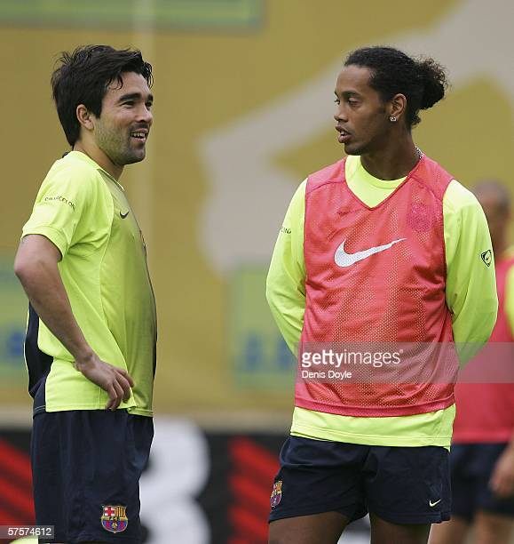 Ronaldinho of Barcelona talks with team mate Deco at the UEFA Champions League Media Day in the Masia club training grounds on May 10 2006 in...