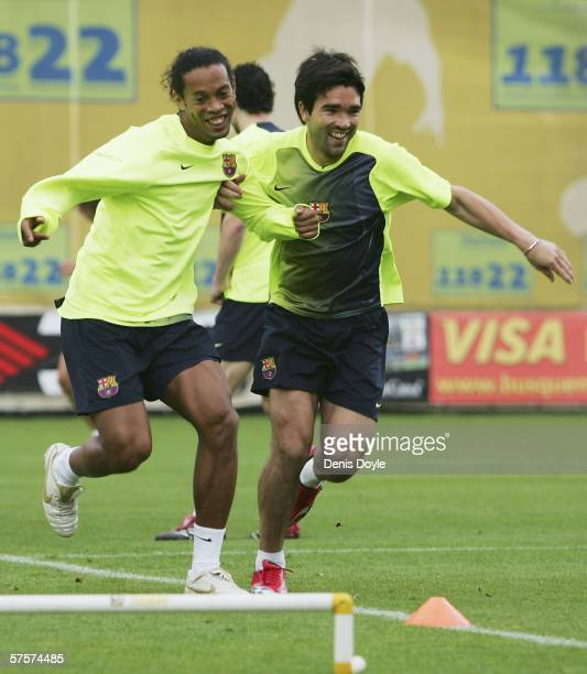 Ronaldinho of Barcelona trains with Deco at the UEFA Champions League Media Day in the Masia club training grounds on May 10 2006 in Barcelona Spain