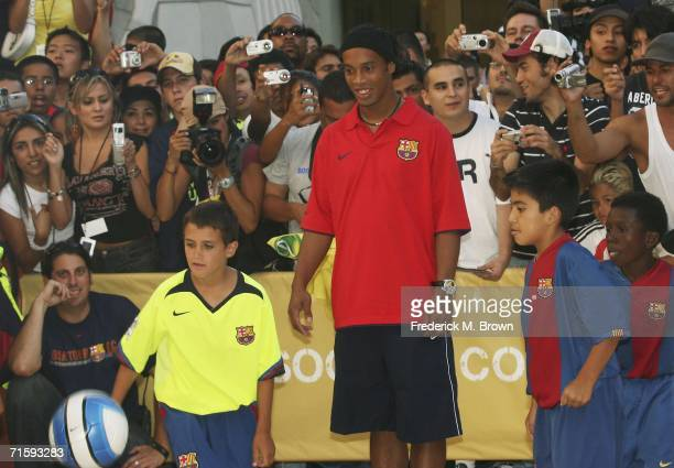 Ronaldinho of Brazil and fans kick a soccer ball at Nike European Club Champion FC Barcelona Rally at Hollywood and Highland on August 5 2006 in...