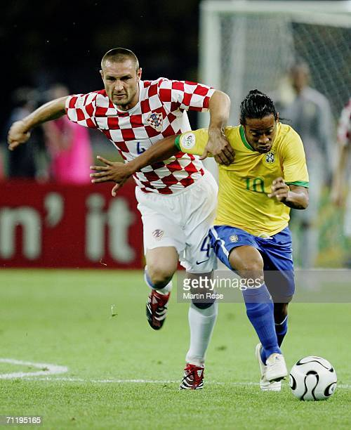 Ronaldinho of Brazil attempts to elude the attention of Robert Kovac of Croatia during the FIFA World Cup Germany 2006 Group F match between Brazil...