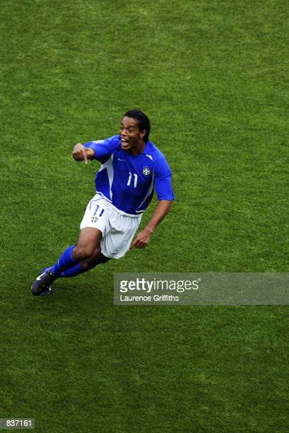 Ronaldinho of Brazil celebrates after scoring Brazil's second goal during the England v Brazil World Cup Quarter Final match played at the Shizuoka...
