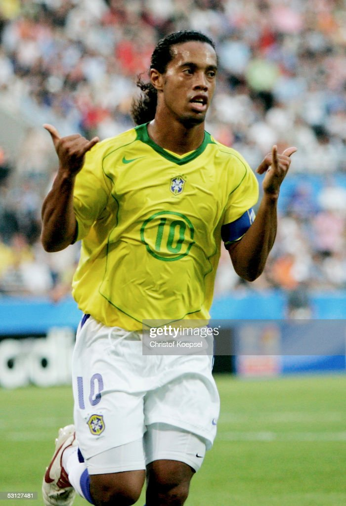 Ronaldinho of Brazil celebrates his first goal during the match between Japan and Brazil for the Confederations Cup 2005 at the RheinEnergie Stadium on June 22, 2005 in Cologne, Germany.