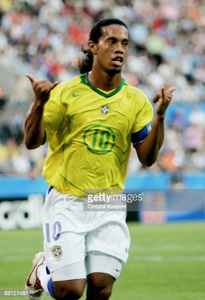 Ronaldinho of Brazil celebrates his first goal during the match between Japan and Brazil for the Confederations Cup 2005 at the RheinEnergie Stadium...